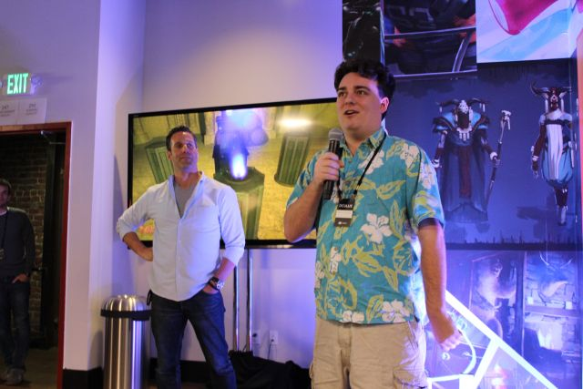 Luckey (right) speaks at an event promoting VR games (and not Donald Trump).
