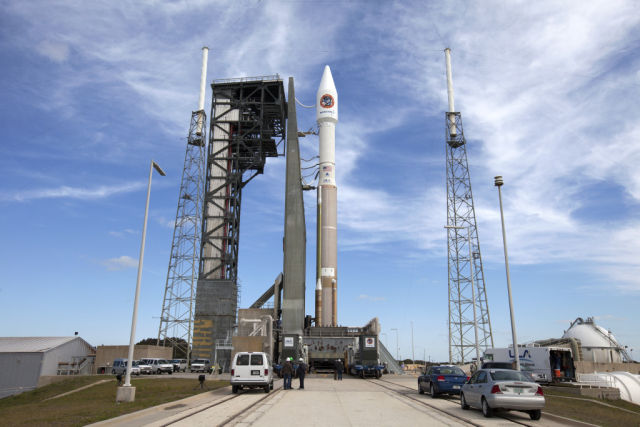 The Atlas V rocket and the S.S. Rick Husband spacecraft are rolled out to the launch pad at Kennedy Space Center.