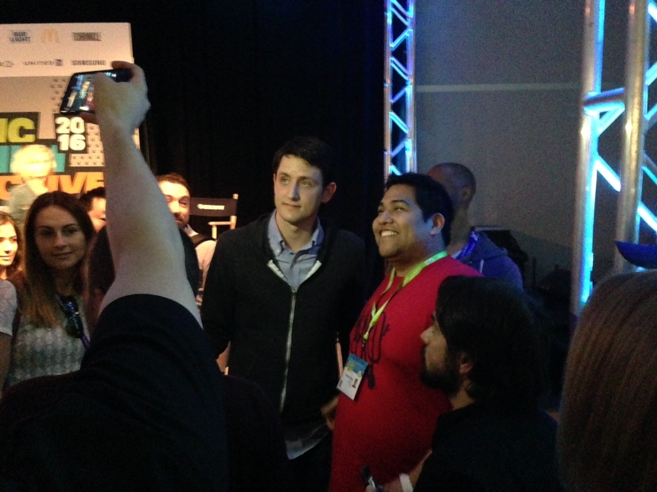 Zach Woods, who plays Jared on HBO's <em>Silicon Valley</em>, takes a photo with a fan at SXSW.