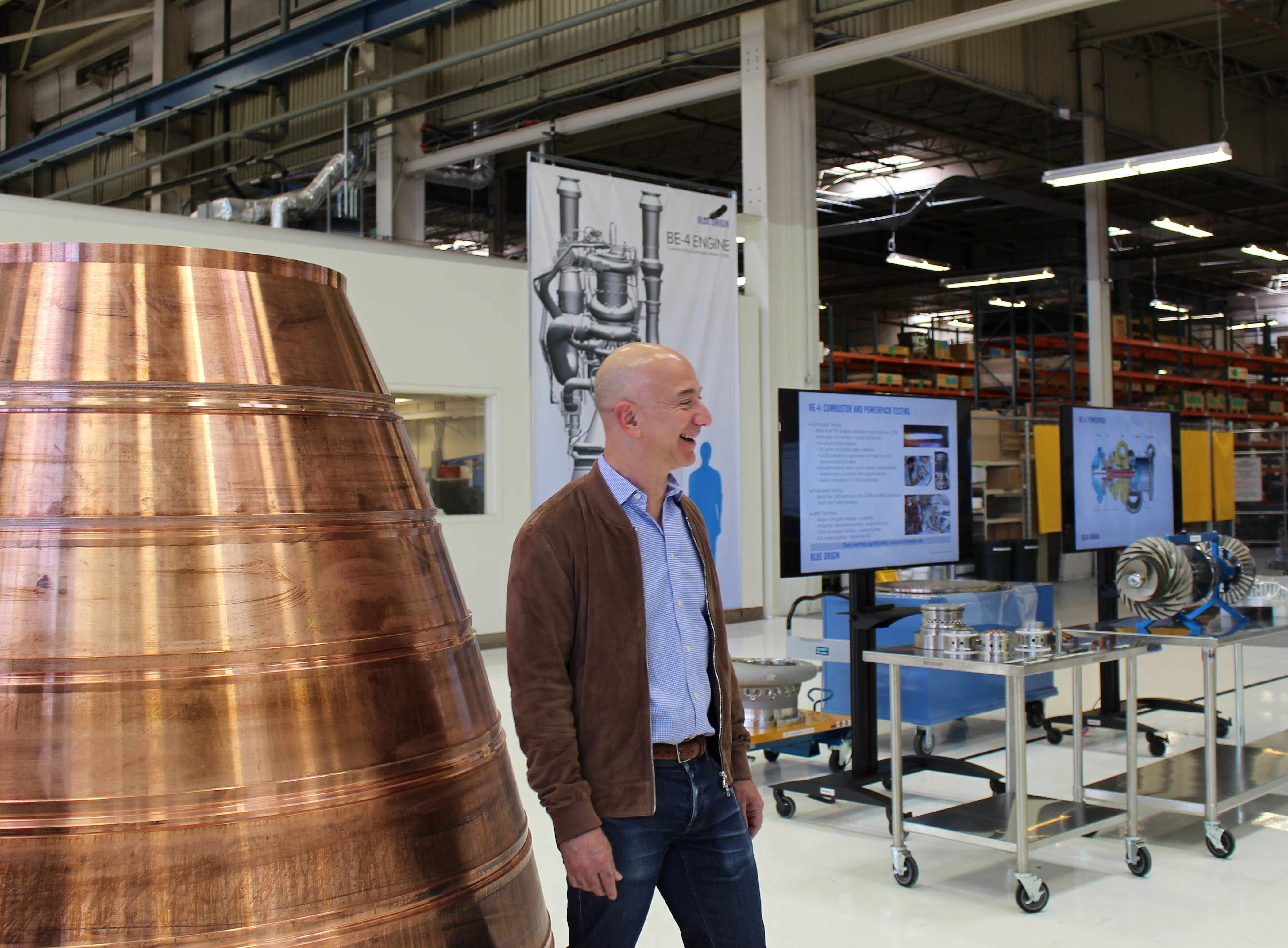 Jeff Bezos stands next to the copper lining for a BE-4 engine nozzle.