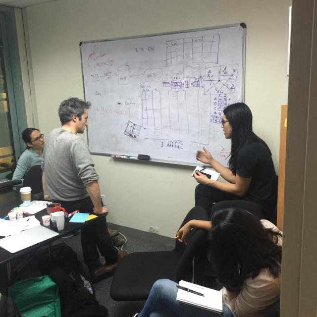 Google software engineers John Li and Zora Tung with UNICEF research scientist Manuel Garcia Herranz and UX designer Tanya Bhandari working on the open source data platform.