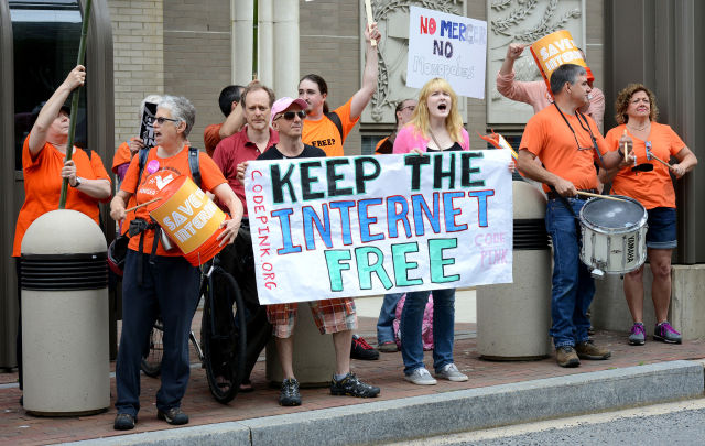Protesters rally at the FCC in 2014 in favor of net neutrality rules.
