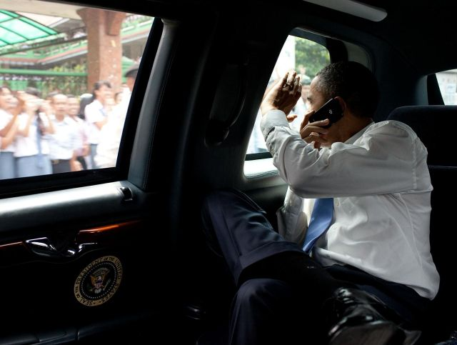 President Obama places a call from his secure BlackBerry 8900 from the presidential limo while in Indonesia in 2010.  When he took office, Obama pushed to keep a mobile device for unclassified use.