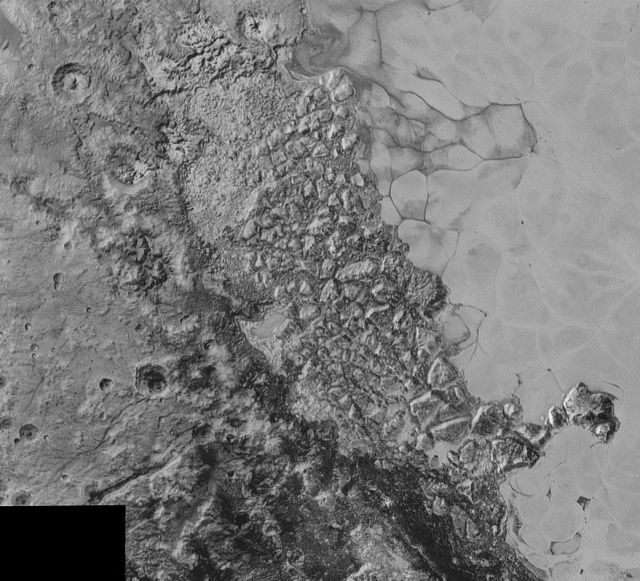 The jumbled mountains (al-Idrisi Montes) on the western edge of Pluto's heart. On the right side of the image you can see some of the nitrogen ice convection cells.