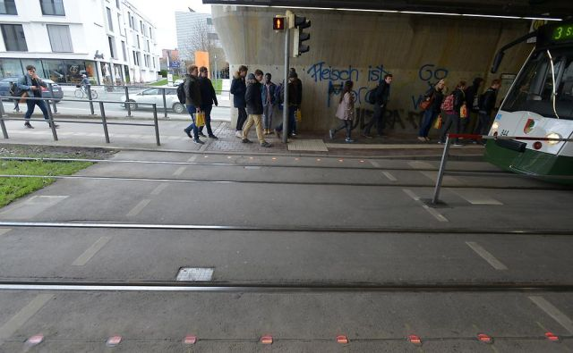 German city embeds LED red lights into sidewalks for smartphone addicts