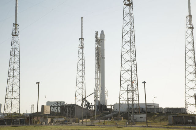 The Dragon spacecraft sits atop the Falcon 9 rocket in preparation for launch on Friday,