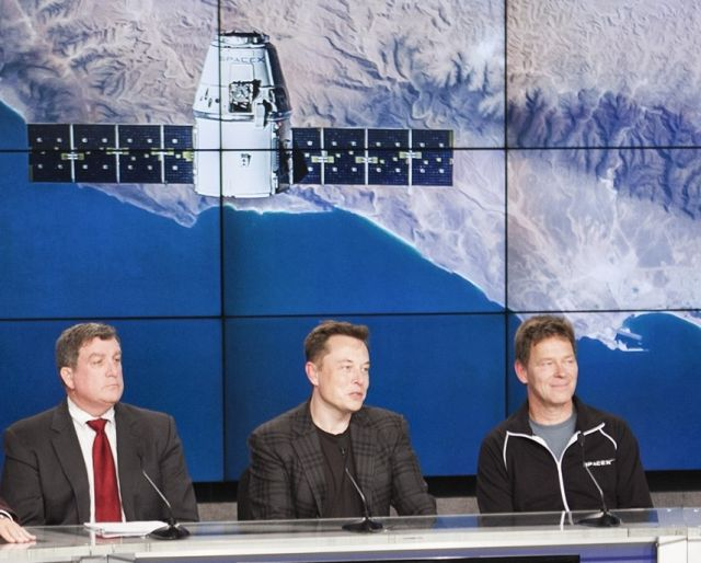 NASA's Kirk Shireman, left, was content to watch as Elon Musk handled all the questions after the dramatic Falcon 9 rocket landing.