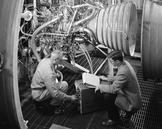 Engineers test the RL-10 engine in NASA Lewis (now Glenn) Research Center's Propulsion Systems Laboratory.