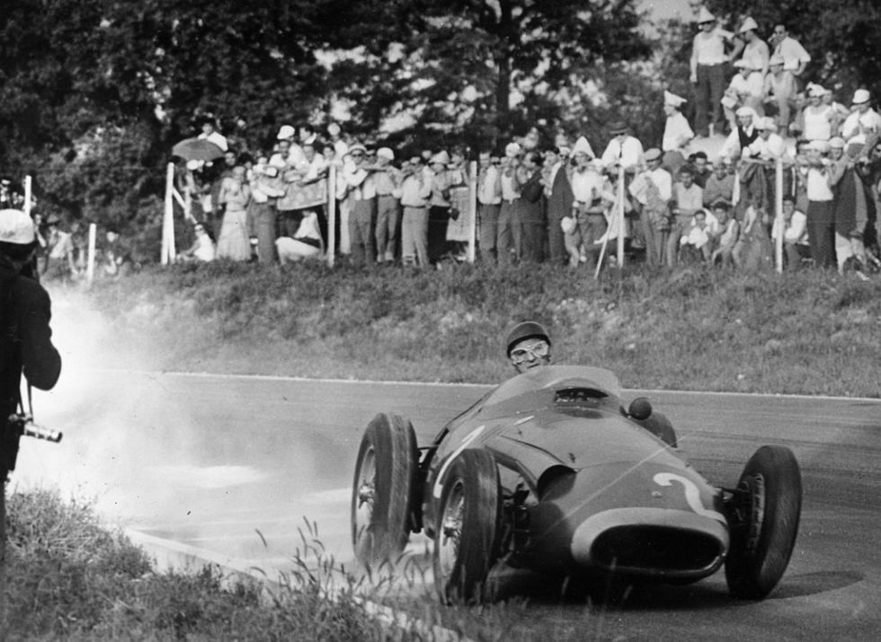 September 11, 1957:  World champion Argentinian racing driver Juan Manuel Fangio in action driving a Maserati at the 1957 Italian Grand Prix at Monza. He finished second behind Stirling Moss in a Vanwall.