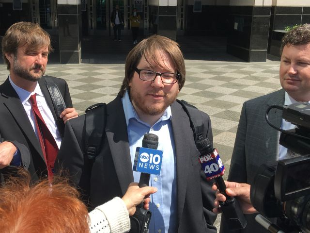Matthew Keys spoke to reporters on April 13, 2016 after his sentencing hearing in federal court in Sacramento, California.