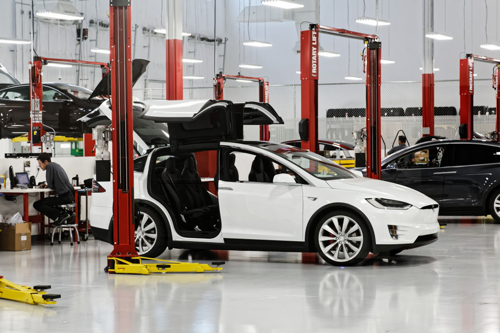 A new crossover SUV Model X, sitting in Tesla's service bay in Houston.