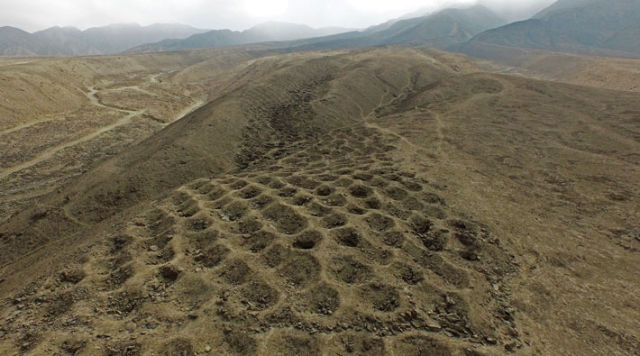 The Band of Holes in a photograph taken by drone. The road stretches for a mile up a mountain top and may be the remains of a structure used for collecting and measuring food tributes for the Inca state.