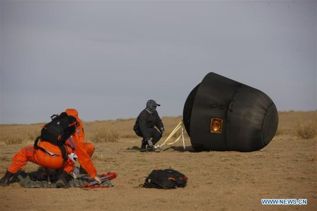 The reentry capsule for the SJ-10 research mission is shown after landing in inner Mongolia on Monday.