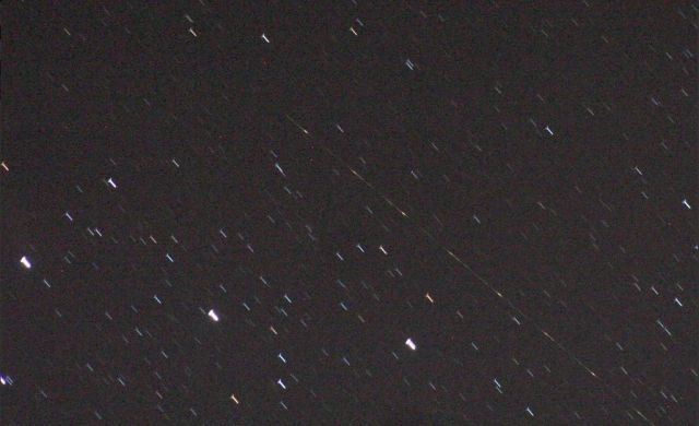 Pieces of Japan's Hitomi satellite are seen tumbling through the Orion constellation Sunday night.