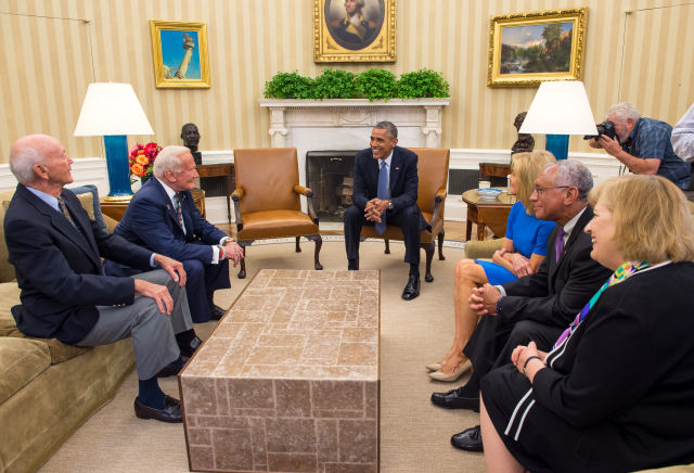 Buzz Aldrin, left of President Obama, visited the Oval Office in 2014.