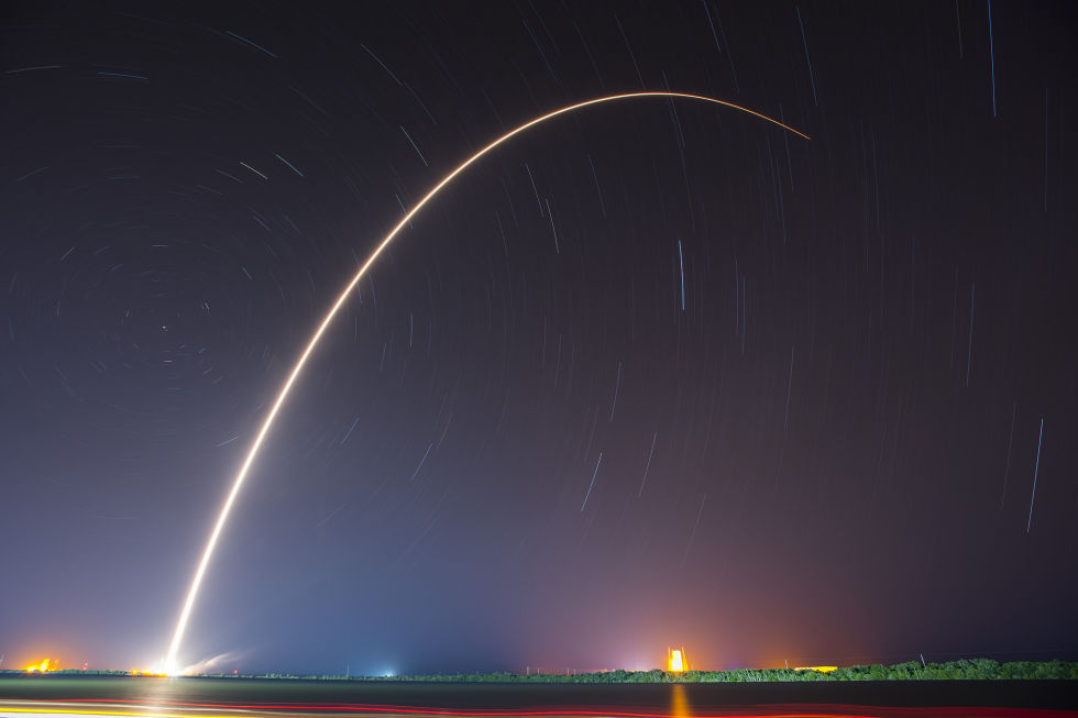 The Falcon 9 rocket sliced a dazzling arc through the early morning Florida sky on Friday.