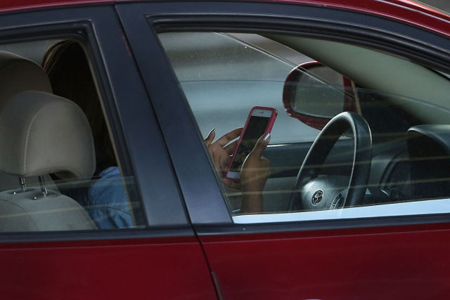 Theresa May says using mobile phone while driving is repugnant