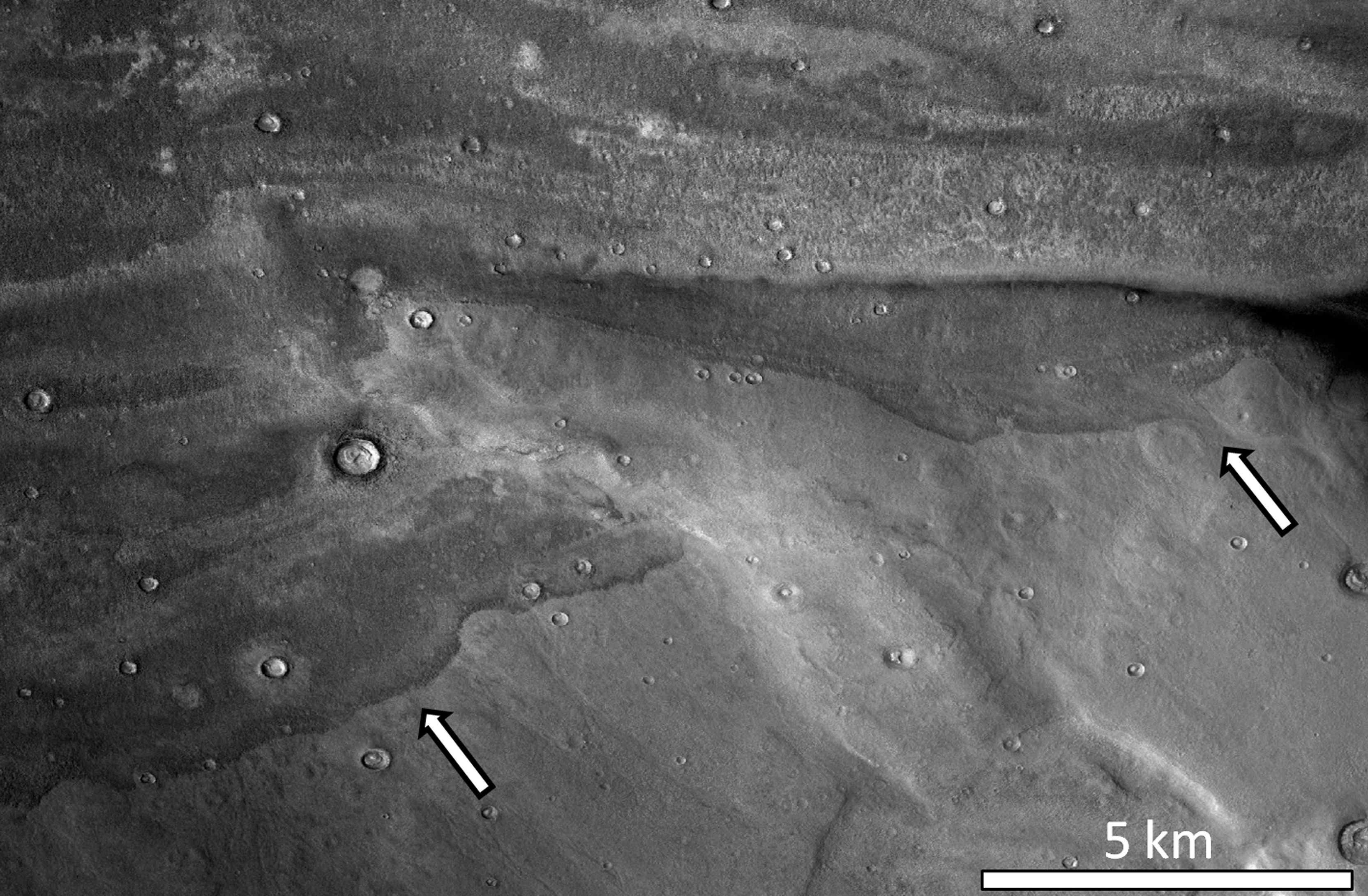 White arrows indicate the edges of the ancient deposits.