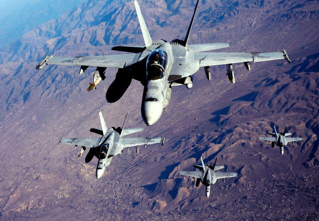 US Navy F/A-18F Super Hornets stack up for refueling over Afghanistan in 2010. Canada is looking to the latest Super Hornet as a way to put off buying F-35s.