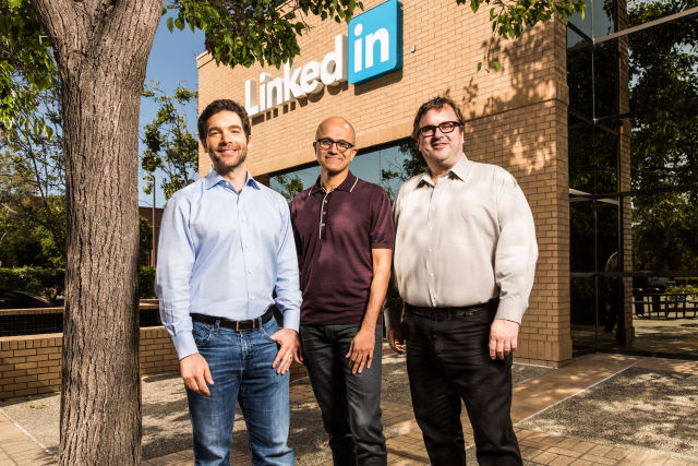 LinkedIn CEO Jeff Weiner (left) and Chairman Reid Hoffman (right) with Microsoft CEO Satya Nadella (center). Microsoft bought LinkedIn last year.