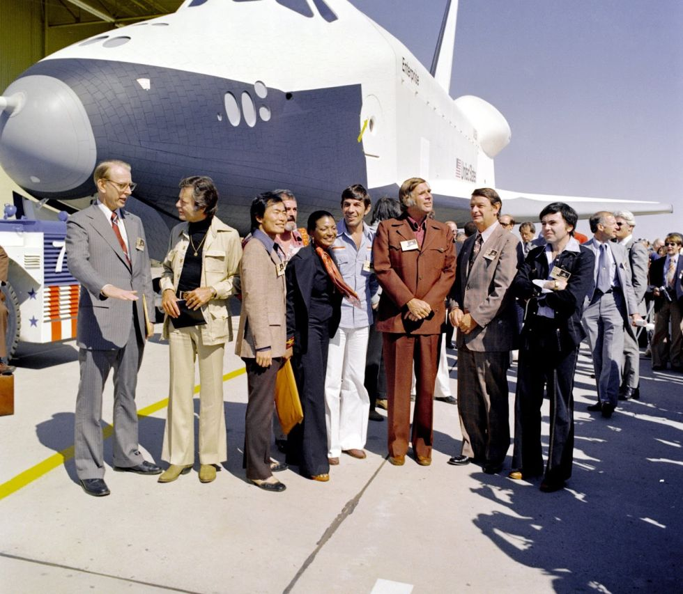 The crew of <em>Star Trek</em> gathers around space shuttle <em>Enterprise</em> in 1977.