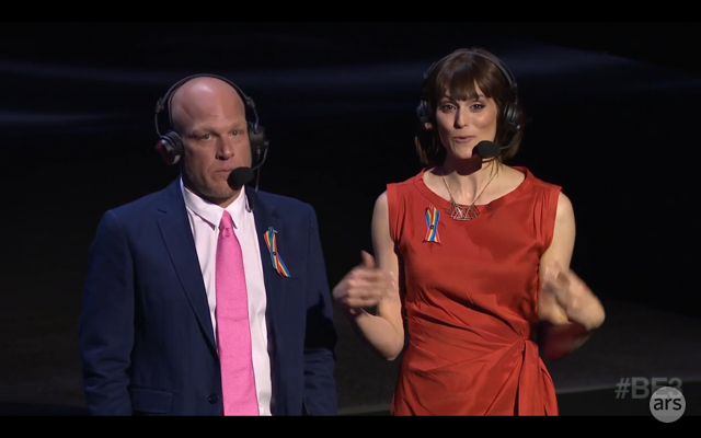 Presenters Adam Sessler and Morgan Webb sport rainbow pins during Bethesda's pre-E3 press conference.