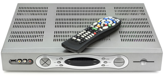 A cable TV box and remote control.