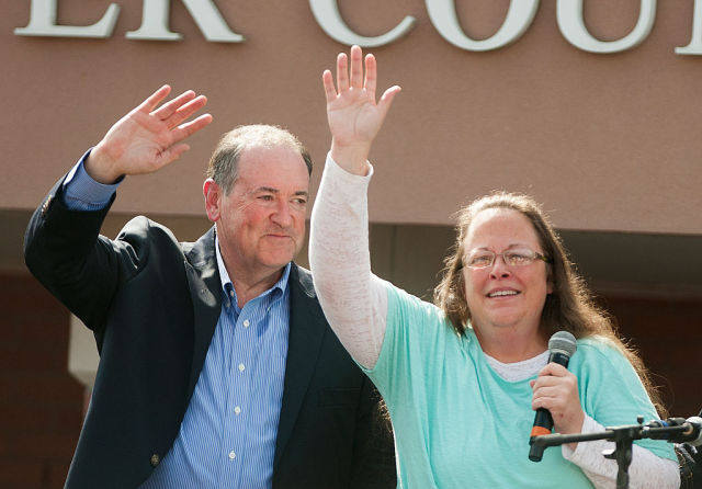 Former Republican presidential candidate Mike Huckabee stands with Kim Davis outside the Carter County Detention Center on September 8, 2015.