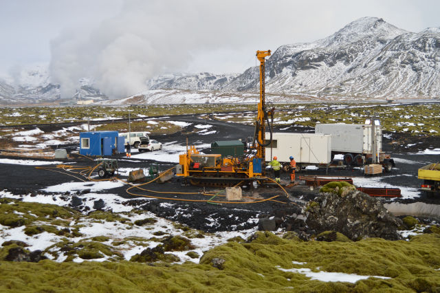 Drilling at the CarbFix site, with the Hellisheiði geothermal power plant in the background.