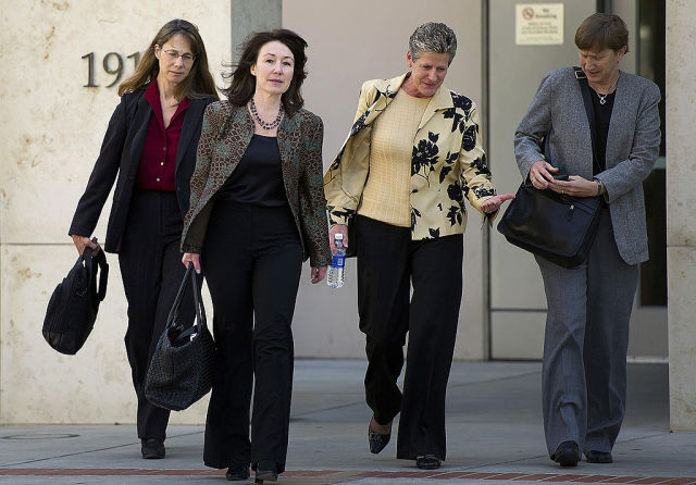 Safra Catz, Oracle Corp. CEO, second left, exits superior court in San Jose in 2012.