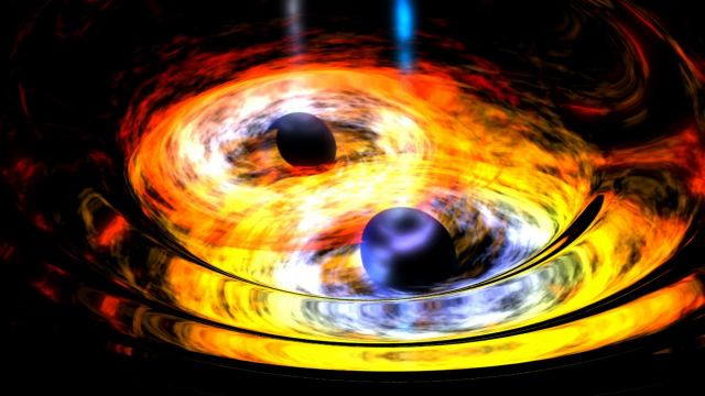Artist's rendition of two in-spiraling black holes.