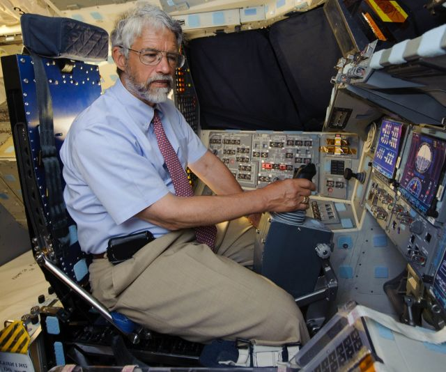 John Holdren, President Obama's science advisor, sits in the commander's chair of space shuttle Discovery in 2011.