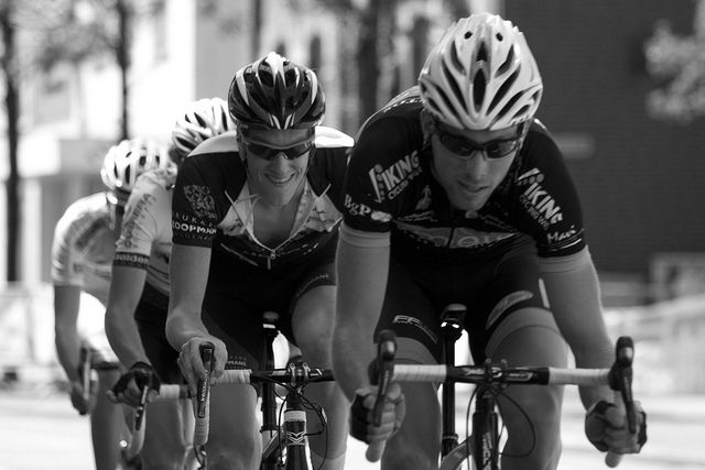 Bicycle racers—even those on different teams—often cooperate to allow the entire group to go faster.