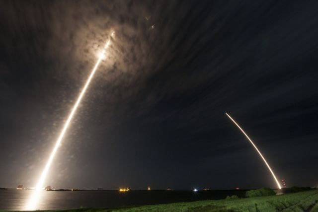 The launch lights up night-time clouds, and is later followed by the landing.