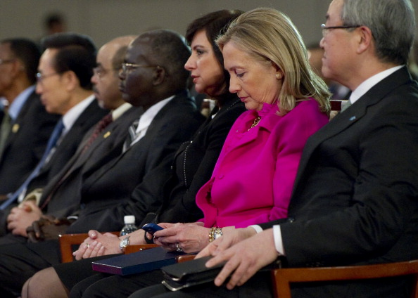 US Secretary of State Hillary Clinton checks her Blackberry phone alongside Korean Foreign Minister Kim Sung-hwan (R) as she attends the Fourth High Level Forum on Aid Effectiveness in Busan, Korea, November 30, 2011. Clinton used the uncleared, personal device throughout her four years at the State Department in conjunction with a private mail server in her home.