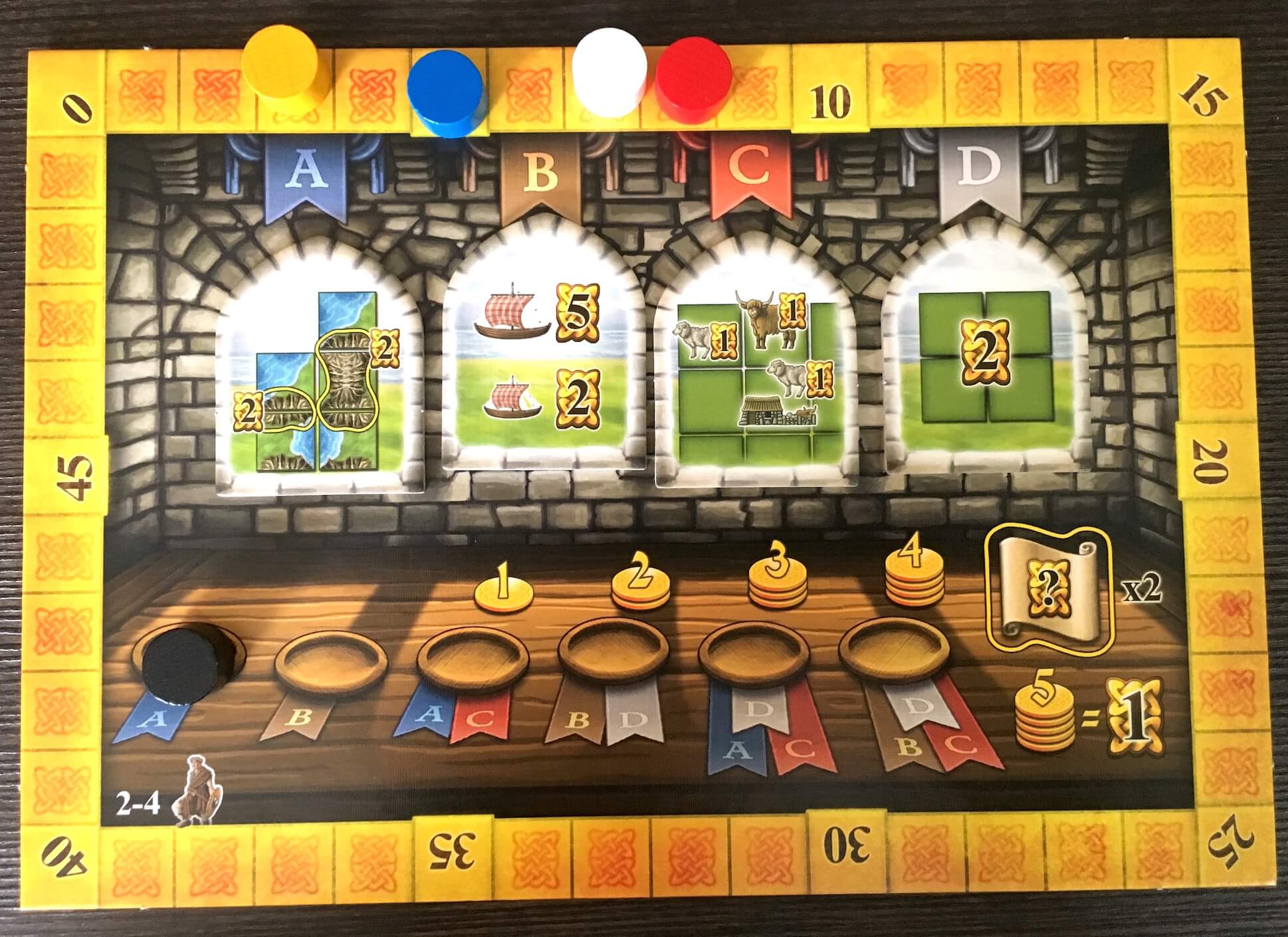 The central board holds the scoring tiles and tracks the progress of the game.