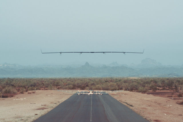 Facebook's Aquila drone takes off from its launch dolly.