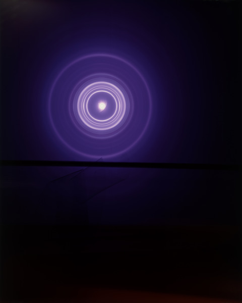 This work won't be found at the Newspace Center for Photography, but it's an example of Bolen's other science-focused work. This one is a print from a piece called Landscape Investigation #2. Color transparency film exposed to the Advanced Photon Source Beam at Argonne National Laboratory.