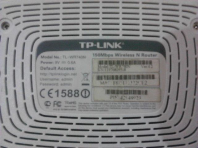 This (blurry) picture shows the bad domain name printed on the bottom of a TP-Link router.