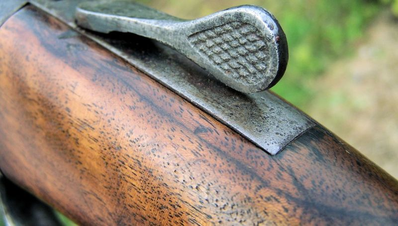 Close-up of a shotgun.