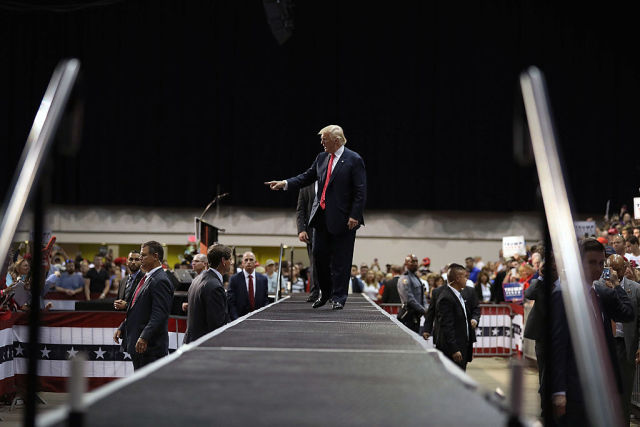 Republican presidential nominee Donald Trump leaves after speaking during his campaign event on August 3, 2016 in Daytona, Florida.