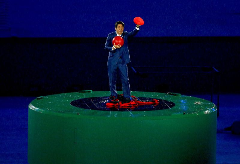 Japan's PM emerges from green pipe dressed as Mario, accepts Olympic torch