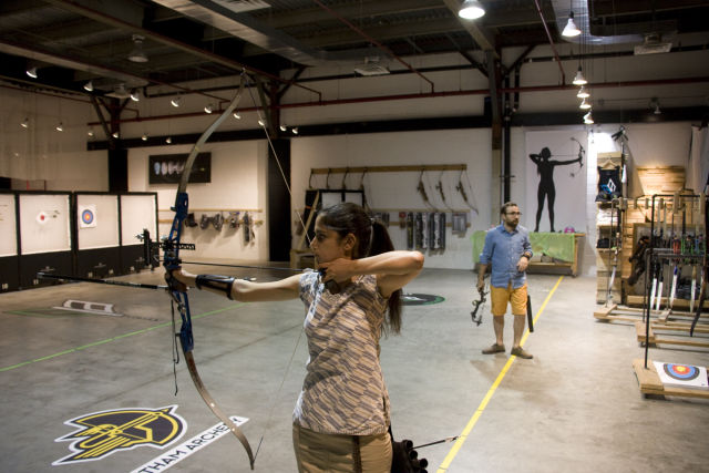 Our tour guide, Anjalie Field, gets ready to let loose. Note the stabilizers extending out from her bow's riser (one is behind her arm).