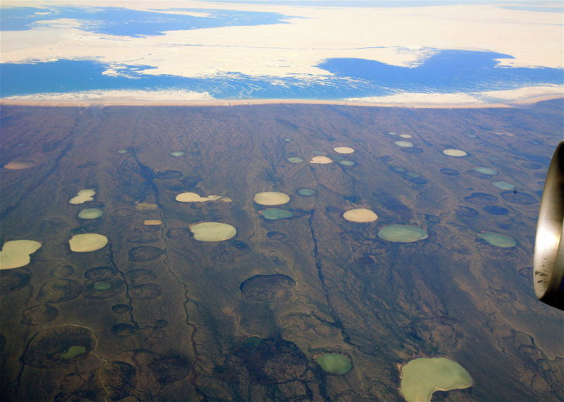 Lakes formed by melting permafrost, on peatland. In Hudson Bay, Canada.