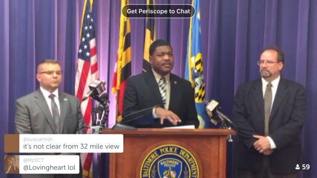 BPD spokesman TJ Smith (center) addressed reporters on Wednesday to discuss the city's aerial surveillance program.