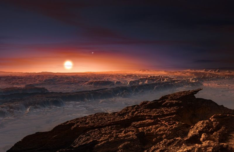 An artist's impression of the view of the surface of the planet Proxima b orbiting the red dwarf star Proxima Centauri.