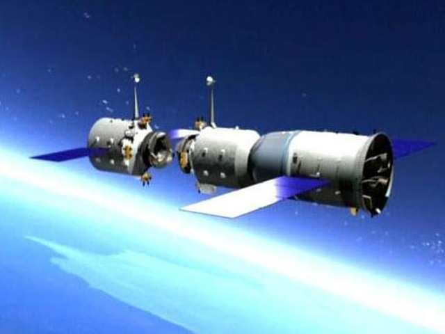 Artist's concept of Tiangong-1 space station with a Shenzhou spacecraft docking.