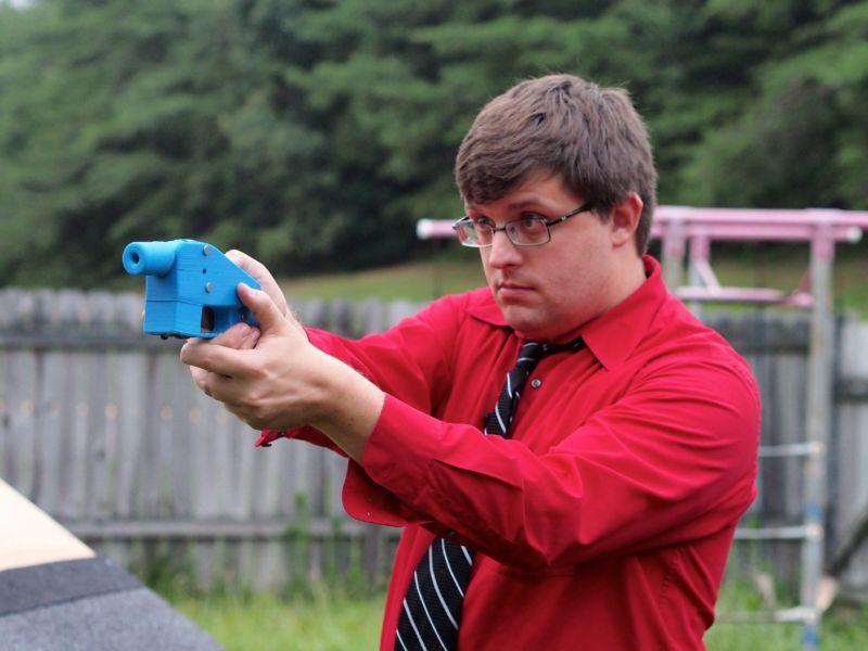 Software engineer Travis Lerol takes aim with an unloaded Liberator handgun in 2013.