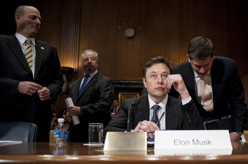 Elon Musk prepares to testify at a Senate Appropriations subcommittee hearing in Washington, D.C., U.S., on Wednesday, March 5, 2014.