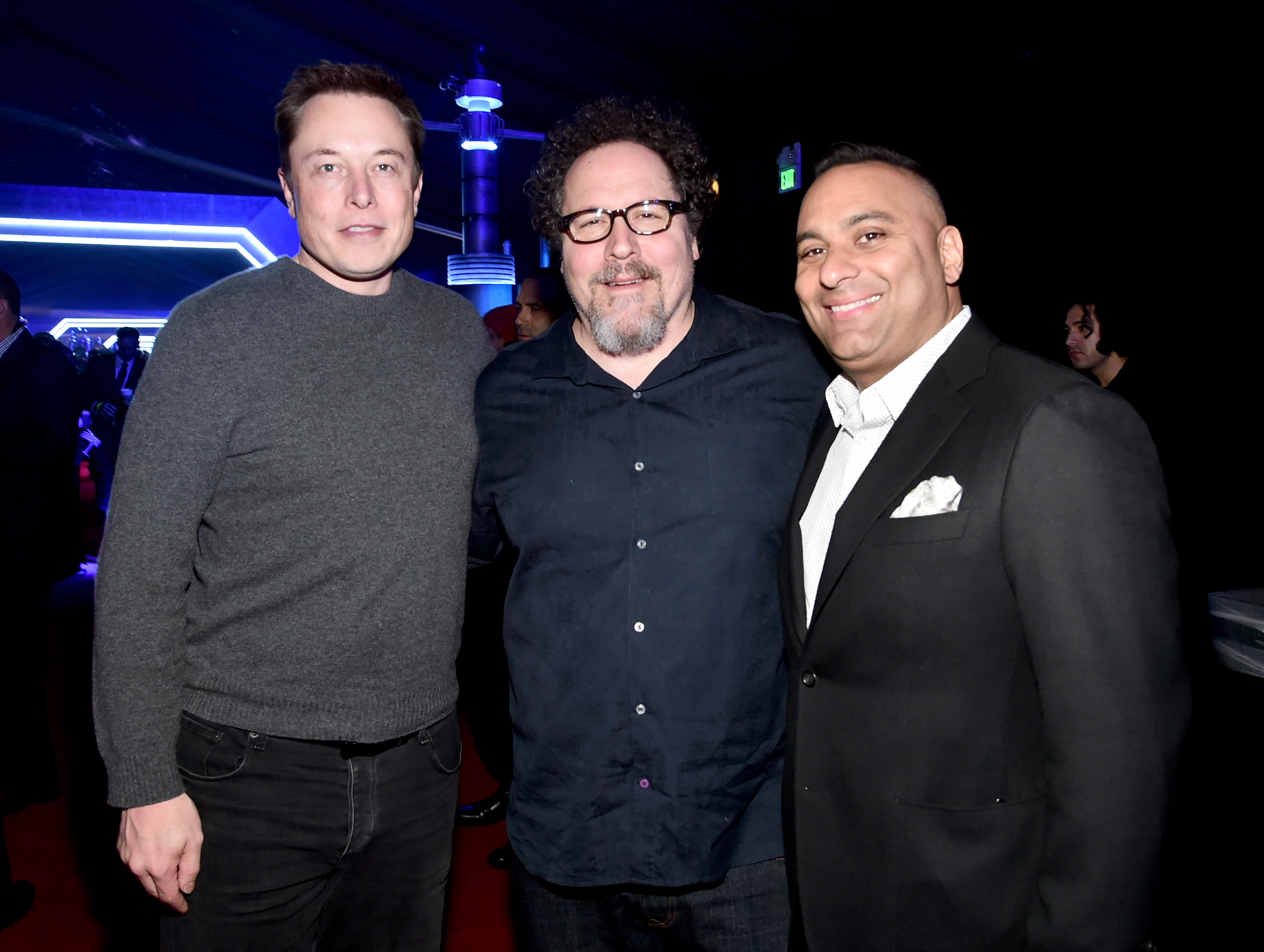 "Elon Musk, actor-director Jon Favreau, and comedian Russell Peters attend the after party for the World Premiere of ""<em>Star Wars: The Force Awakens</em>"" on Hollywood Blvd. on December 14, 2015."